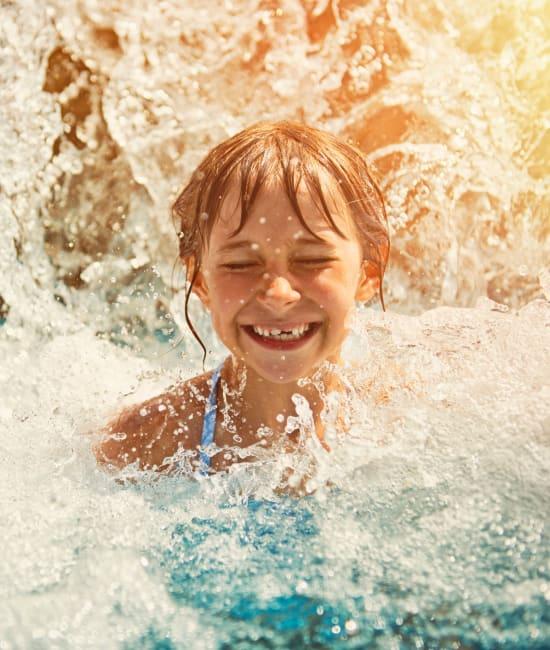 Resident swimming in pool of Auburn Townhomes in Auburn, California