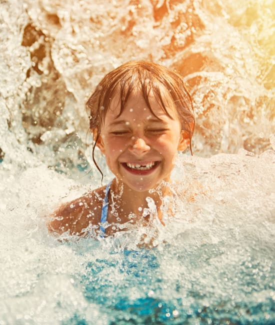 Resident swimming in pool of Meritage Apartments in Lodi, California