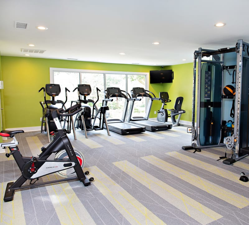A fitness center with a spin bike at Woodlake Reserve in Durham, North Carolina