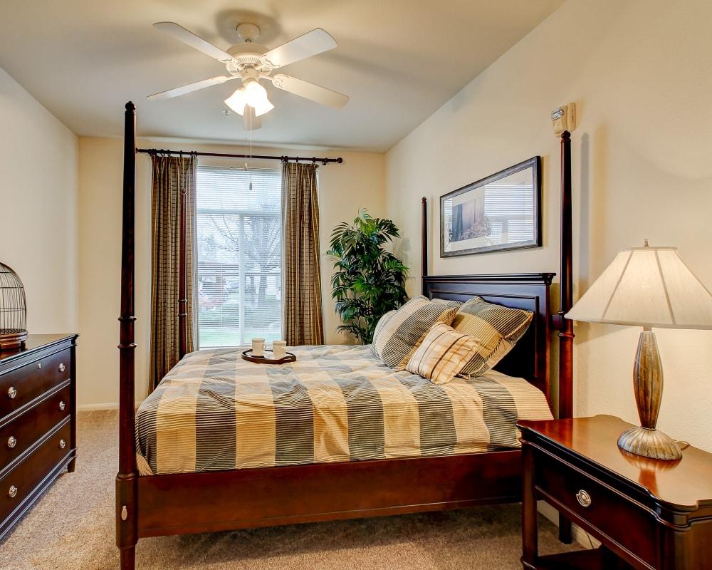 Spacious bedroom with a large window at Laguna Creek Apartments in Elk Grove, California
