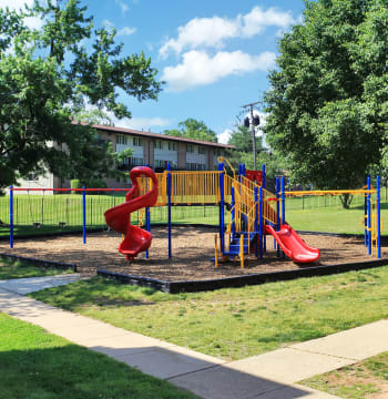 Playground on a beautiful sunny day with blue skies at Suitland, Maryland near Allentown Apartments