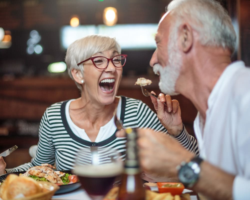 Residents eating dinner at Prairie Hills Cedar Rapids in Cedar Rapids, Iowa.