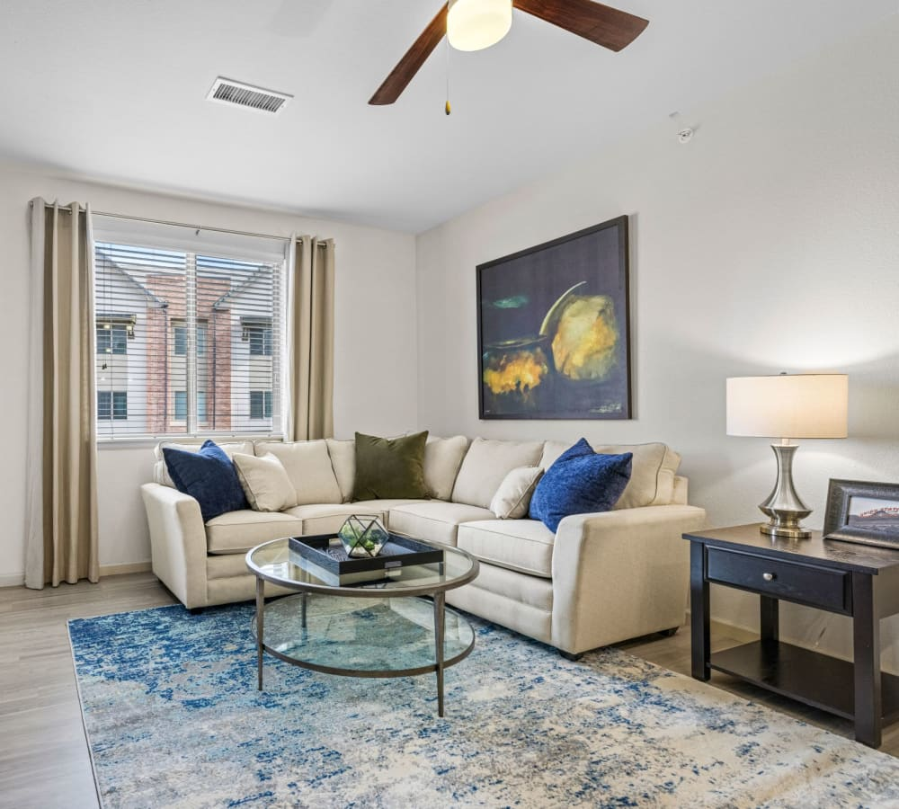 Well decorated living room with ceiling fan and area rug at The Parc at Greenwood Village in Greenwood Village, Colorado