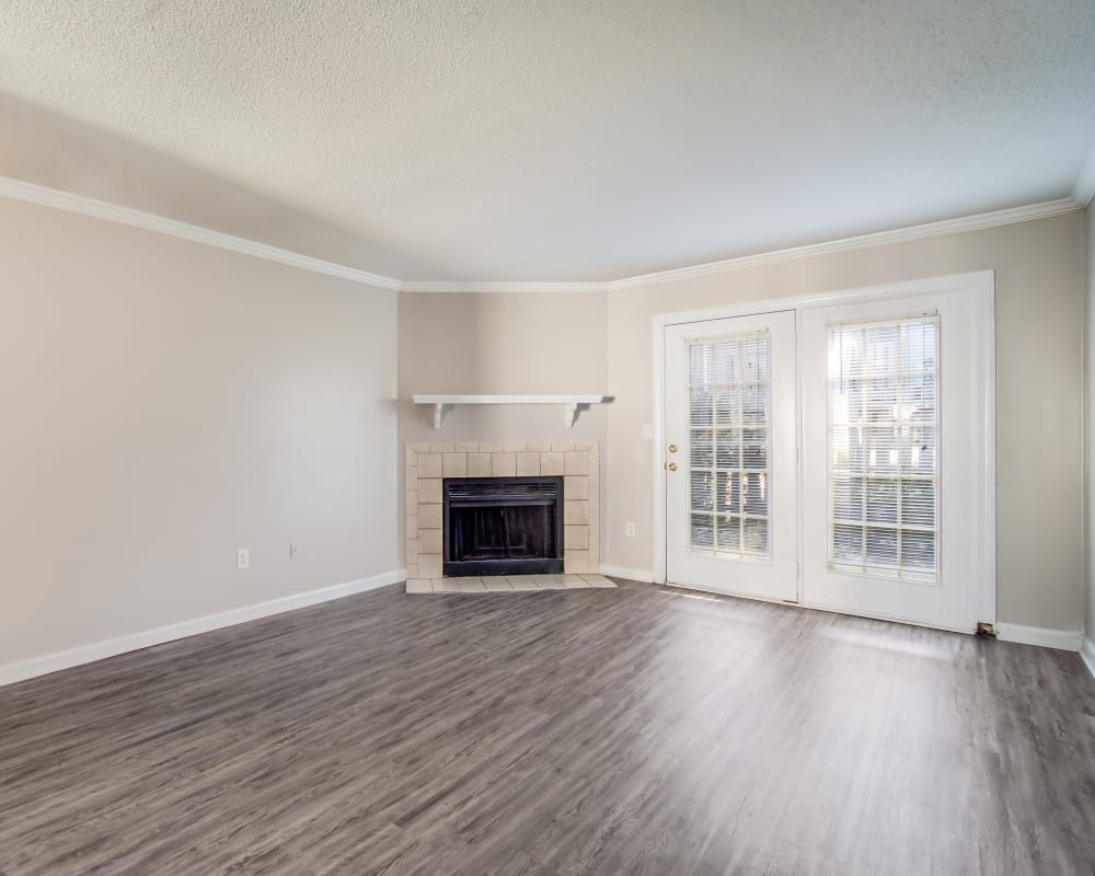 Spacious living room with a fireplace at 220 West Townhomes in Augusta, Georgia