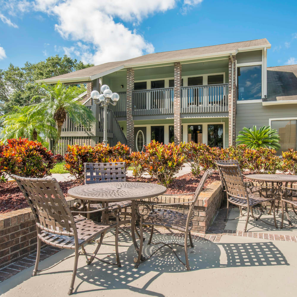 Sundeck with plenty of table and chairs for entertaining guests at Compass in Melbourne, Florida