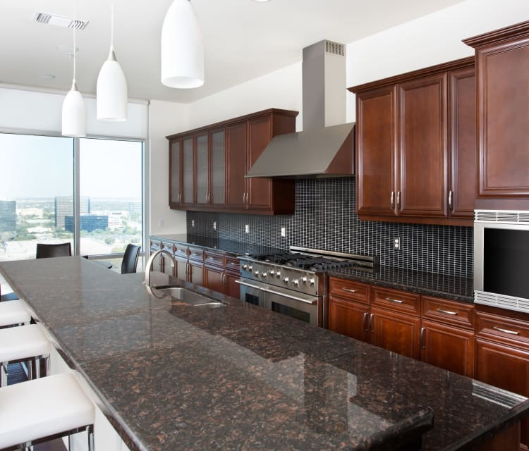 Handsome kitchen accents and dark wood cabinetry at The Heights at Park Lane