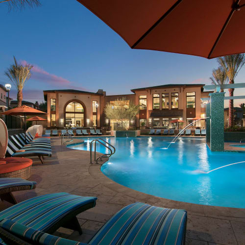 Beautiful resort-style swimming pool at twilight at Redstone at SanTan Village in Gilbert, Arizona