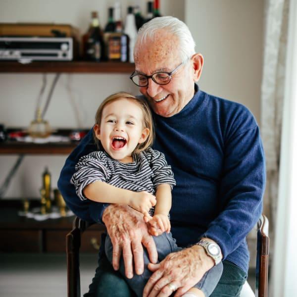 A resident holding his grandson at Monte Vista Village in Lemon Grove, California.