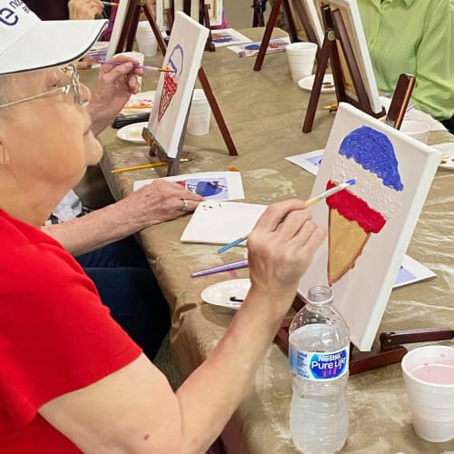 A resident painting at Canoe Brook Assisted Living in Ardmore, Oklahoma