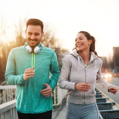 Residents enjoying a run downtown near The Marc, Palo Alto in Palo Alto, California