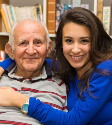 Happy resident with family member at Aspen Valley Senior Living in Boise, Idaho