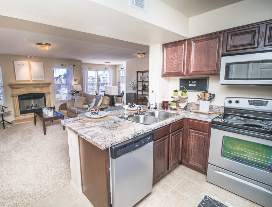 Kitchen with stainless steel appliances at Tuscany Place in Lubbock, Texas