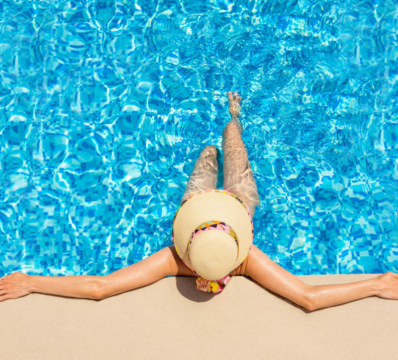 Resident relaxing in the swimming pool at Brookside View in Gaithersburg, Maryland