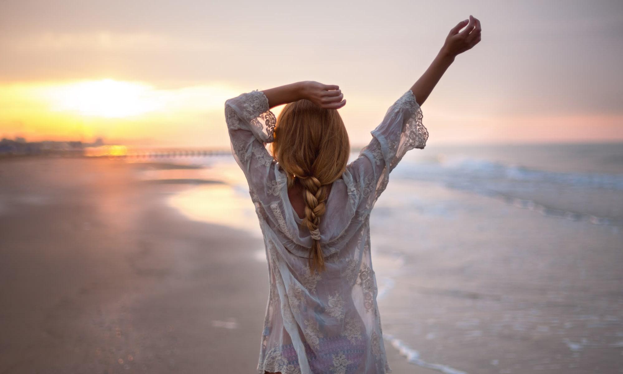 Woman enjoying herself at the beach near Delray Station