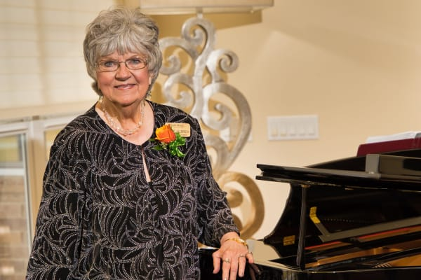 Resident and caregiver at Maple Ridge Gracious Retirement Living in Cedar Park, Texas