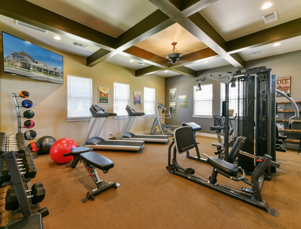Fitness center at Cottages at Abbey Glen Apartments in Lubbock, Texas