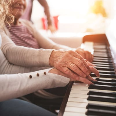 Resident giving a piano lesson at Westminster Memory Care in Lexington, South Carolina