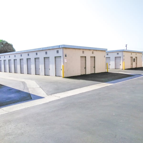 Ground-level outdoor storage units at StorQuest Self Storage in Lakewood, California
