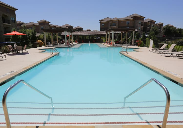 Gorgeous swimming pool area on a beautiful day at Evolv in Mansfield, Texas