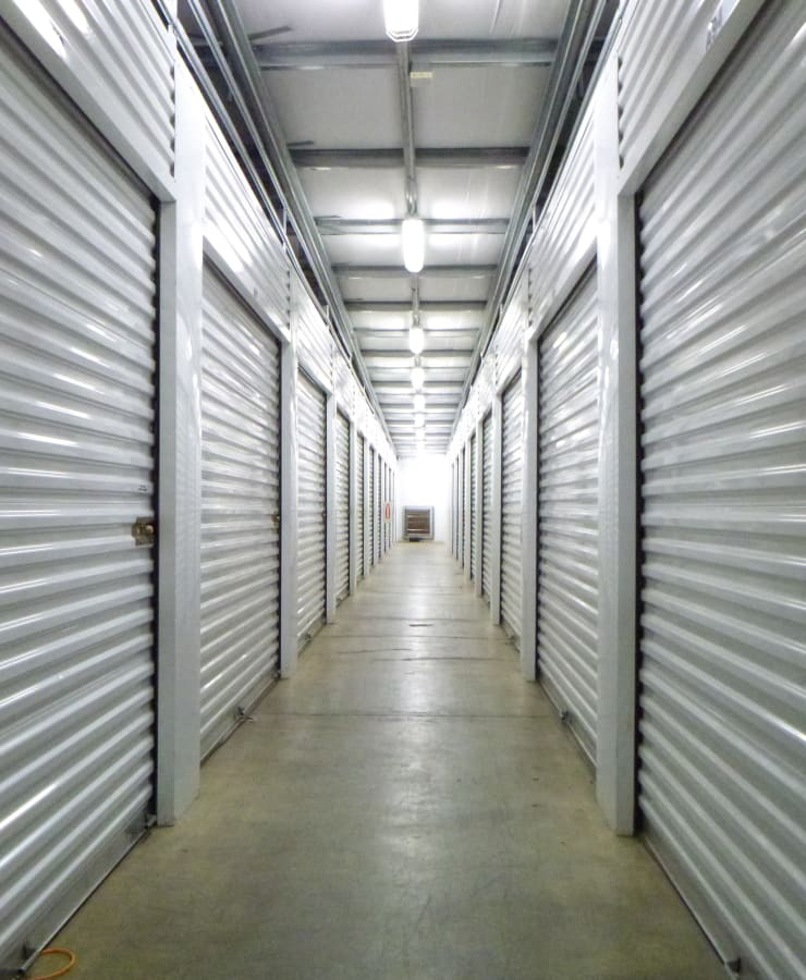 A hall of indoor units with the doors closed at Missouri Flat Storage Depot in Placerville, California
