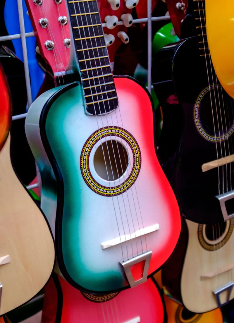 Beautifully painted guitar in a store near Marquis at TPC in San Antonio, Texas