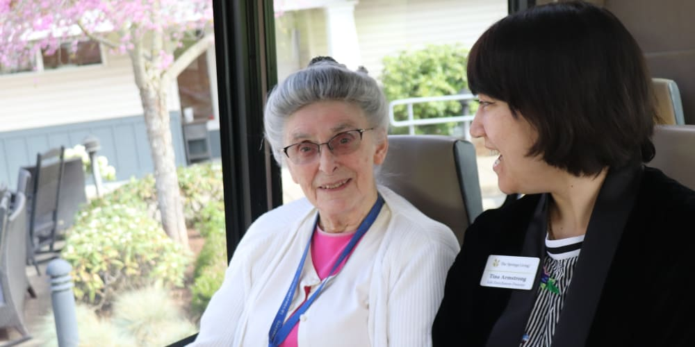 Resident chatting with caregiver while going on a day trip at The Springs at Sherwood in Sherwood, Oregon