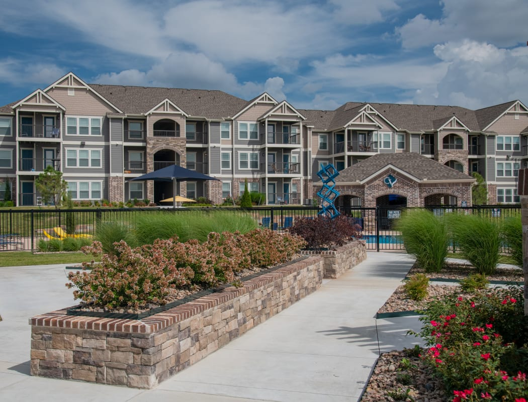 Buildings and pool at Cottages at Crestview in Wichita, Kansas