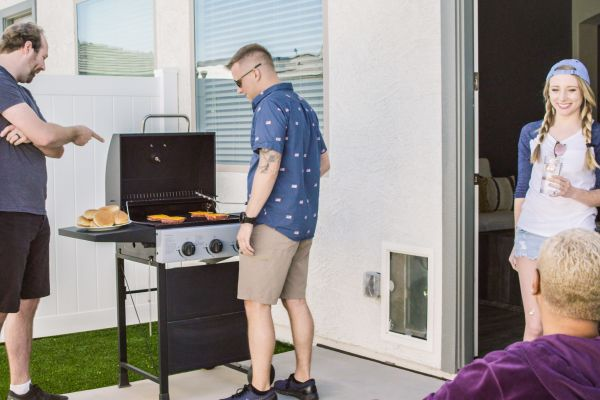 Residents firing up the barbecue on their private patio at Christopher Todd Communities at Country Place in Tolleson, Arizona