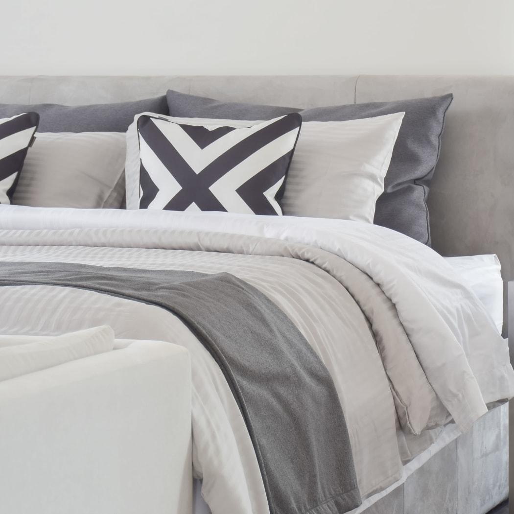 Modern model bedroom at Oak Pointe Apartments in Fremont, California