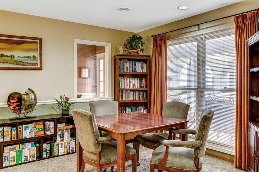 Game and book room with wood accents at Carriage Court of Grove City in Grove City, Ohio