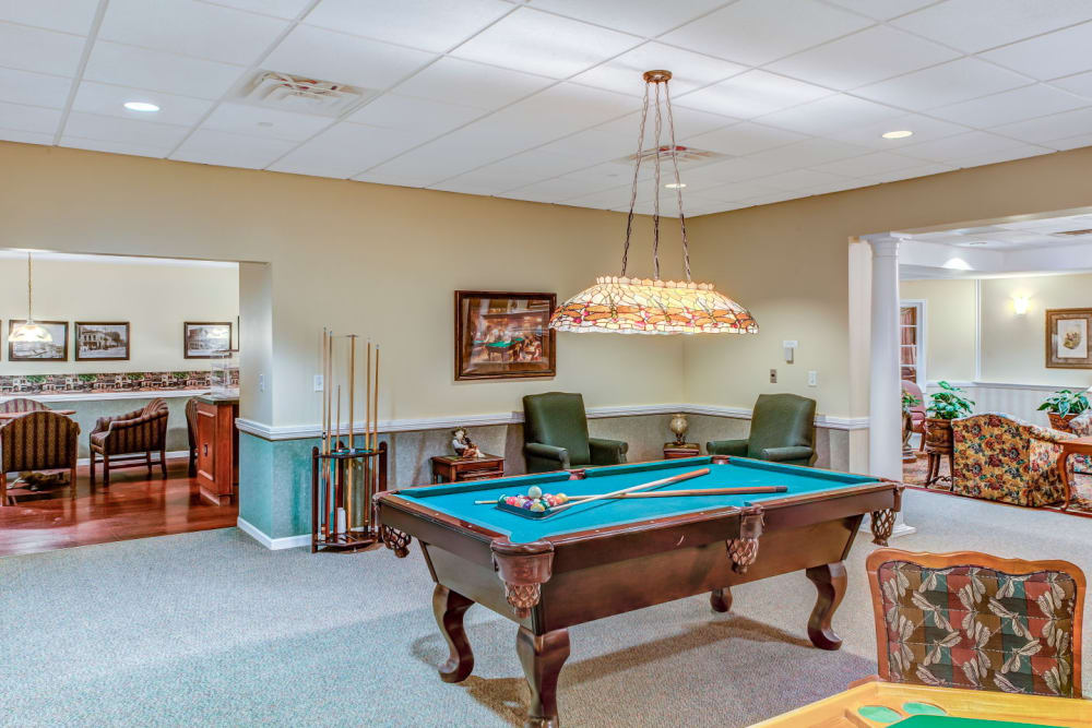Brightly lit game room complete with pool tables at Grand Victorian of Rockford in Rockford, Illinois