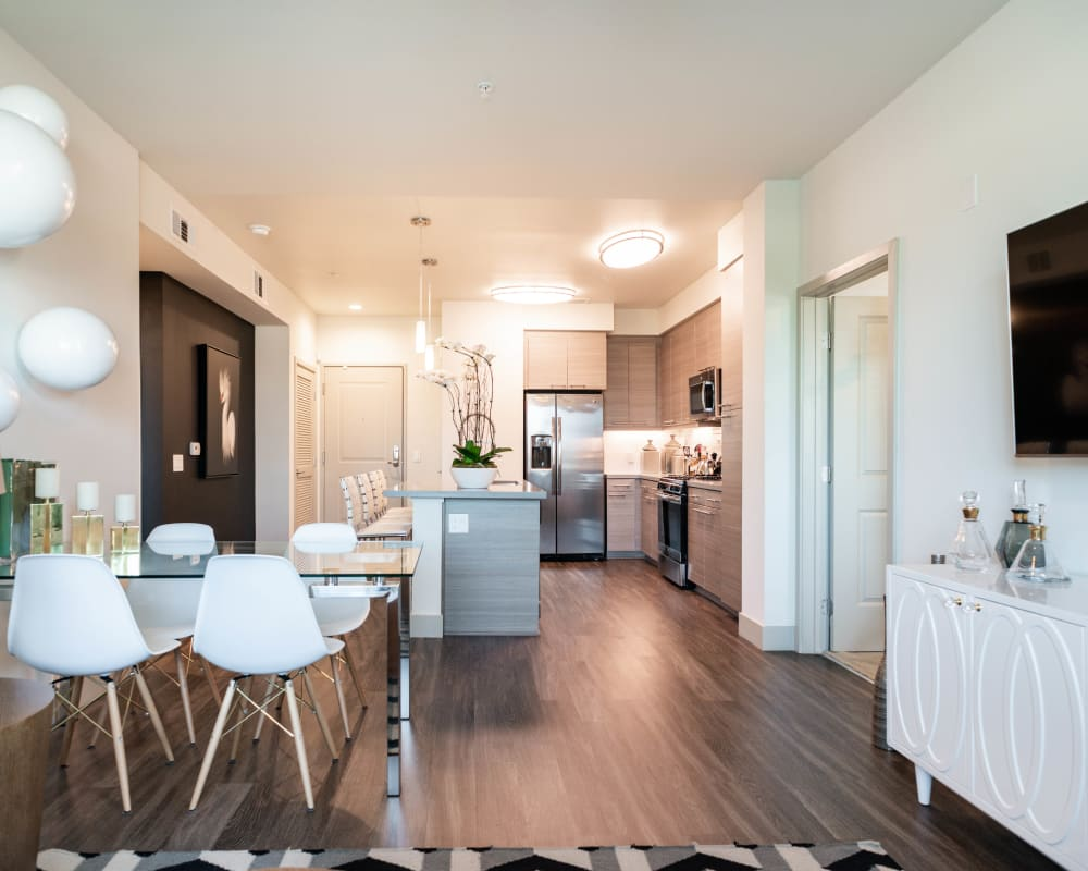 Luxurious decor in a model home's open-concept living areas at Fusion Apartments in Irvine, California