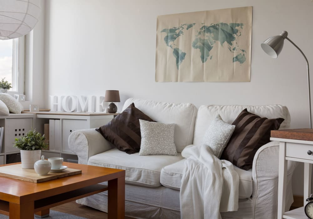 Cozy living room couch at Alcott Place in Baltimore, Maryland