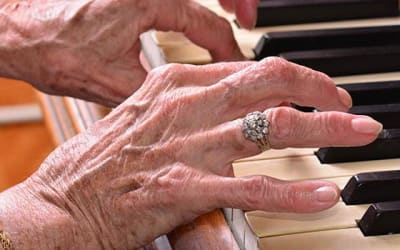 Resident playing piano at Mattison Crossing at Manalapan Avenue in Freehold, New Jersey