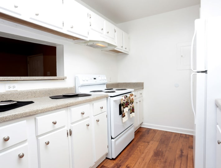 Spacious kitchen at Woodcreek Apartments in Huntsville, Texas