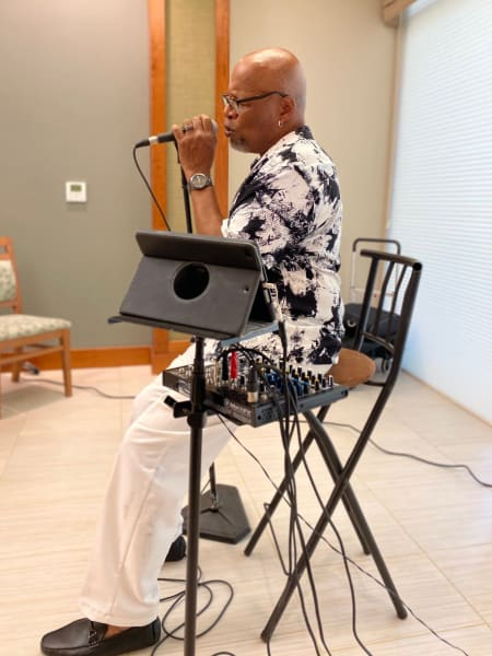 Local jazz singing legend Michael King puts on a show for the residents.