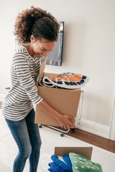 A women moving boxes for storage at Smart Self Storage of Solana Beach in Solana Beach, California