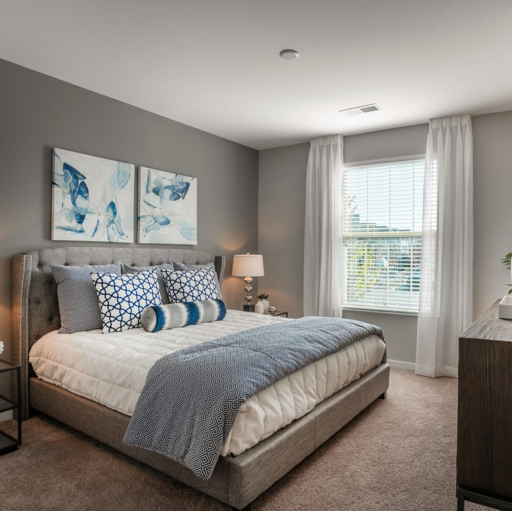 Master bedroom with a large window at Elevate at Brighton Park in Summerville, South Carolina