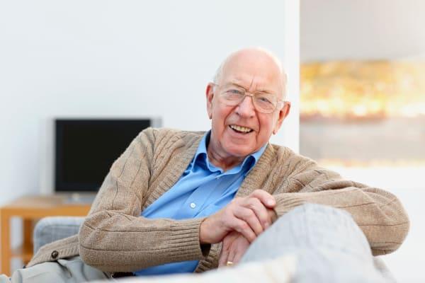 Senior living resident relaxing at Grand Plains in Pratt, Kansas