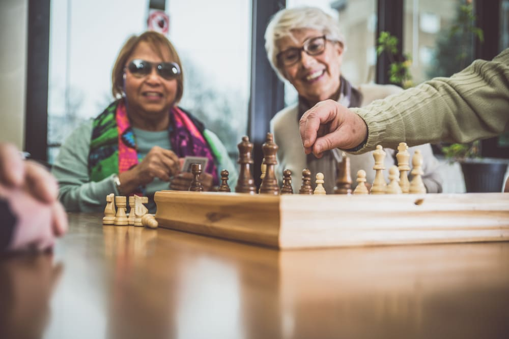 Residents enjoying a game of chess at Holden of Bellevue in Bellevue, Washington