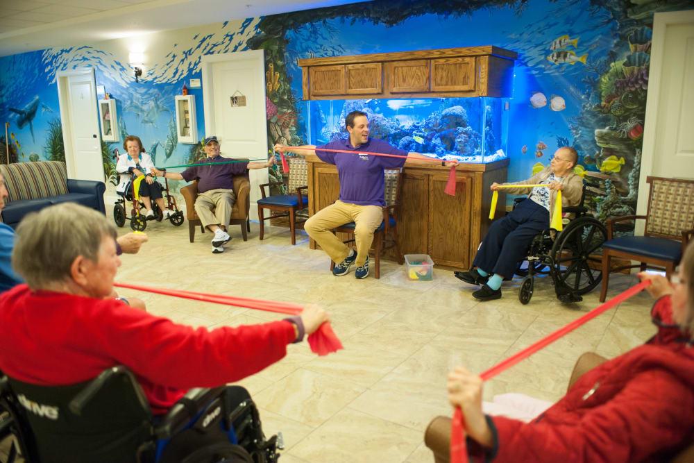 Staff member teaching a wellness class at Inspired Living Sun City Center in Sun City Center, Florida.