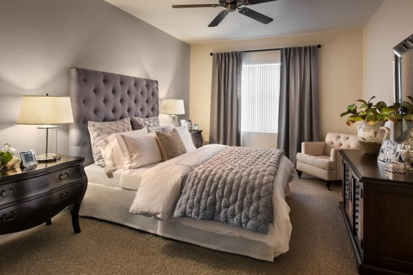 Well-decorated bedroom with ceiling fan in model home at San Paseo in Phoenix, Arizona