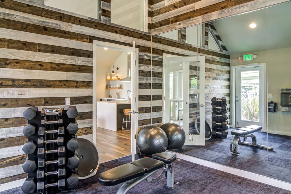 Free weights and more in the fitness center at Heatherbrae Commons in Milwaukie, Oregon