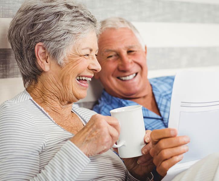 Senior laughing with caregiver at The Wellington in Salt Lake City, Utah