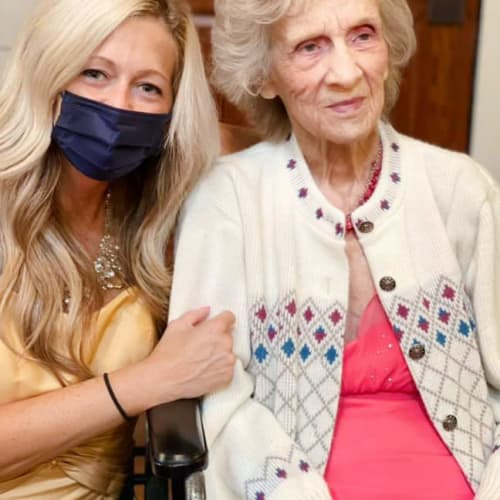 A team member posing with a resident at Oxford Glen Memory Care at Owasso in Owasso, Oklahoma