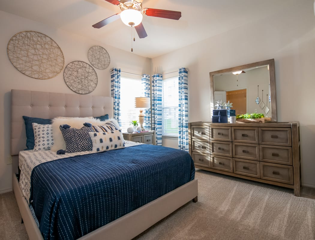 Cozy bedrooms at Bend at New Road Apartments in Waco, Texas.