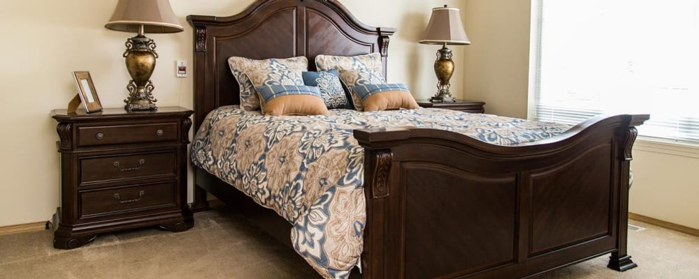 Charming upscale bedroom at The Springs at Butte in Butte, Montana