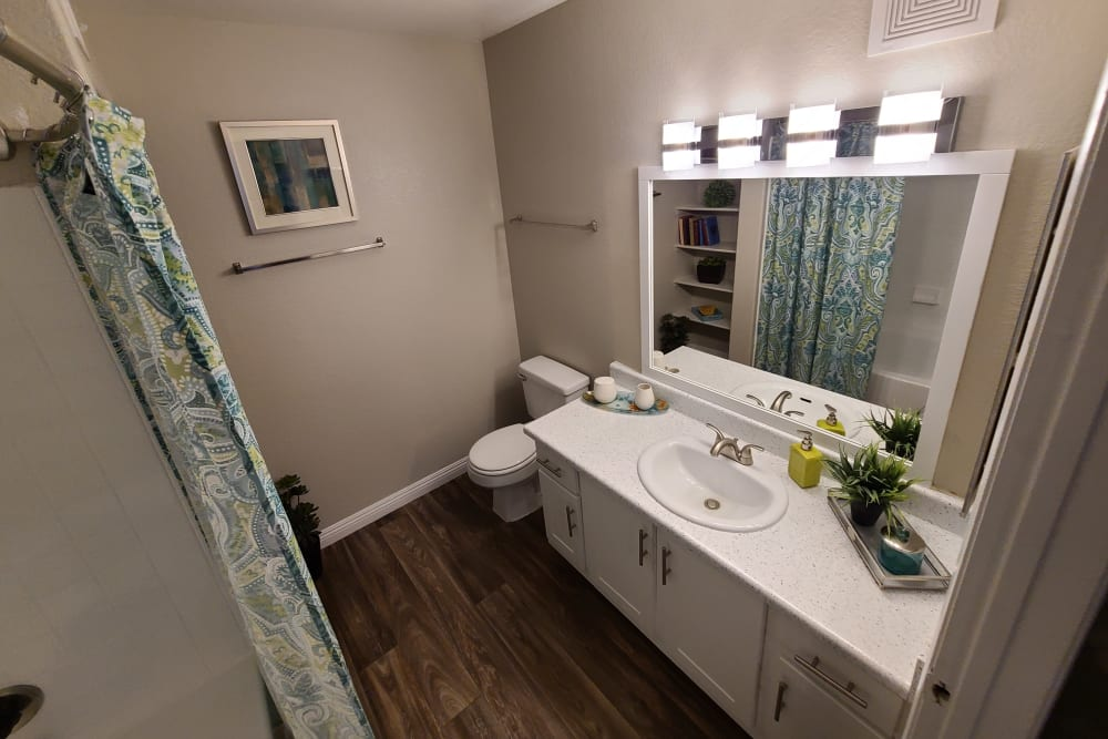 Bathroom with a large vanity at Alterra Apartments in Las Vegas, Nevada