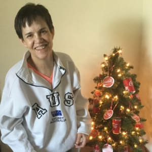 Resident Lisa standing by her Christmas tree at Prairie Hills in Tipton, Iowa