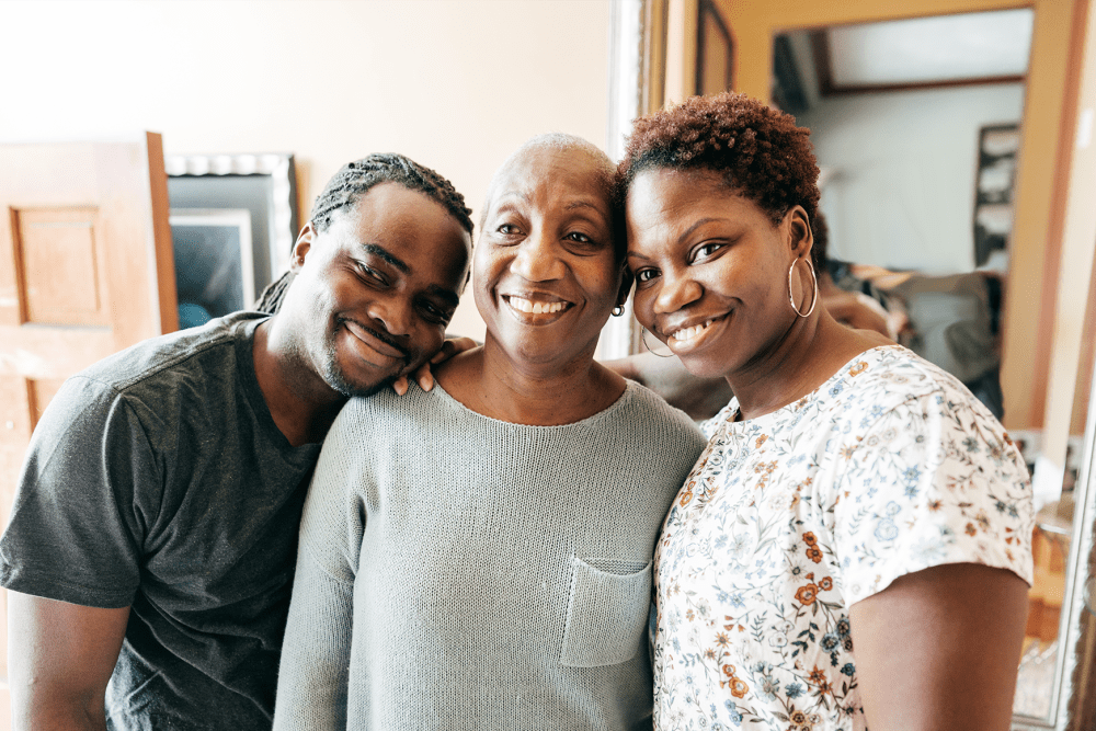 Happy resident with her son and daughter at Sunstone Village in Denton, Texas